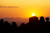 Sunset over eroded landscape with pinnacles and balanced rocks south of Tucson, Arizona, USA
