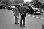 Blair Peach funeral and lying in state. Southall west London 1979. A bus driver and conductor stop their bus get out and pay their respects.