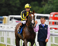 Winner of The Tony Brown's 75th Birthday Handicap, Dandy Flame  ridden by Finley Marsh and trained by Richard Hughes  is led into the winners enclosure during Ladies Evening Racing at Salisbury Racecourse on 15th July 2017