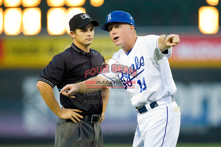 Burlington Royals manager Tommy Shields (19) argues a call with umpire Jimmy Lott during the game against the Danville Braves at Burlington Athletic Park on July 18, 2012 in Burlington, North Carolina.  The Royals defeated the Braves 4-3 in 11 innings.  (Brian Westerholt/Four Seam Images)