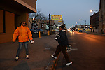 """Cease Fire outreach workers and violence interrupter (l-r) Jerusha """"Rue"""" Hodge, 42, and supervisor Ulysses """"US"""" Floyd, canvass in front of a liquor store where a number of shootings have taken place on 79th Street in South Shore on the South Side of Chicago, Illinois on February 3, 2017.  Cease Fire is a public health initiative that attempts to stop or halt gun violence across the city."""