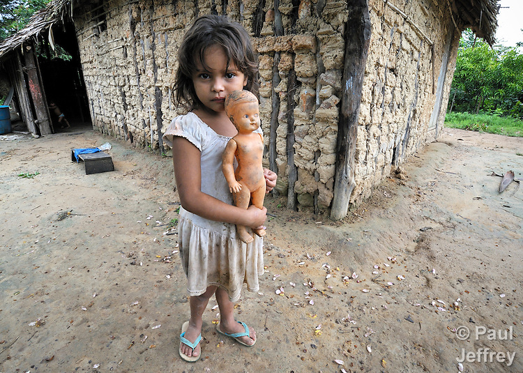 Beatriz Sousa da Silva, a 6-year old girl in the Esperança Sustainable Development Project, in front of her family's house. Her family is part of a pioneering jungle community where U.S. Catholic Sister Dorothy Stang worked. Stang was murdered here for her defense of the jungle and landless poor families like this one which survive there.