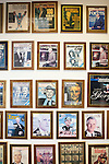 Magazine covers with his face on the front line two walls outside of Ted Turner's office in downtown Atlanta October 29, 2013.