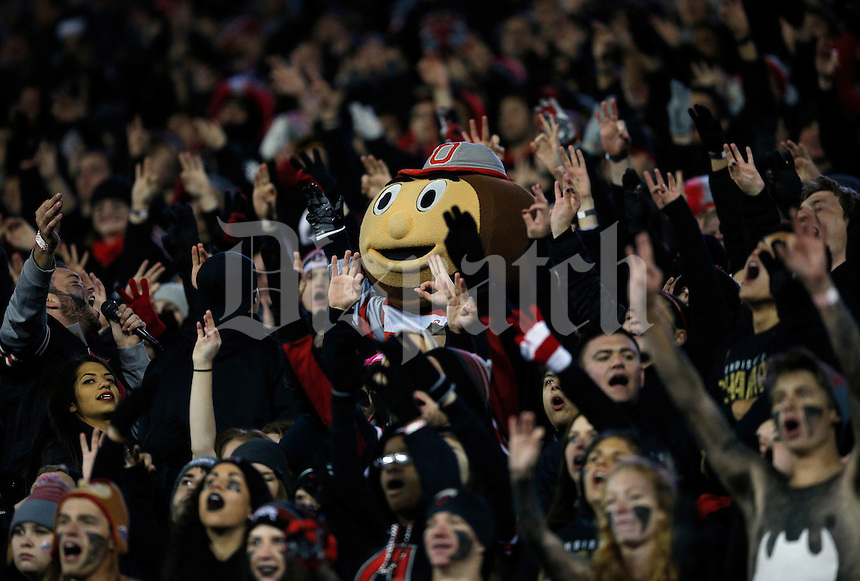 Ohio State mascot Brutus Buckeye cheers with students in the Block O section during the fourth quarter of the NCAA football game against the Penn State Nittany Lions at Ohio Stadium in Columbus on Oct. 17, 2015. Ohio State won 38-10. (Adam Cairns / The Columbus Dispatch)