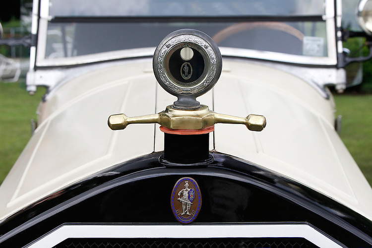 "This cream 1927 Stearns Knight sports a Boyce Motormeter in chrome and gold above the ""knight"" emblem decorating the top of the grill. Car photographed at the 2010 Wings 'n' Wheels Showcase, Galway, New York."