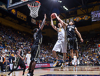 California's David Kravish rebounds the ball away from Colorado during a game at Haas Pavilion in Berkeley, California on March 8th, 2014. California defeated Colorado 66 - 65