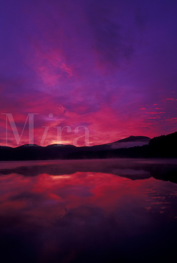 AJ4546, sunrise, sunset, Vermont, The beautiful red and purple sky reflects in the calm waters of Molly Falls Pond at sunrise in Marshfield in Washington County in the state of Vermont.