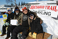 The checking crew at Grayling pose for a photo.  L to R is Steve Mailelle, Richard Nikolai, Darren Deacon and Dennis West on Sunday afternoon.  Iditarod 2009