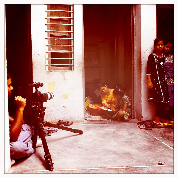 10x10 cameraman filming Parvati, who is enrolled in a Pratham-sponsored after-school program, in India.