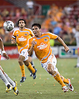 Houston Dynamo forward Brian Ching (25) advances the ball.   Houston Dynamo defeated Toronto FC 3-1 at Robertson Stadium in Houston, TX on June 8, 2008.