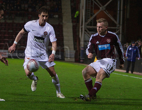 23.12.2012 Edinburgh, Scotland.    Hearts Andrew Driver witht he ball dispite the attention of Dundee United's Rudi Skacel during the Clydesdale Bank, Scottish Premier League game between Hearts  v Dundee United, from Tynecastle Park Stadium.