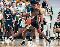 WASHINGTON, DC - NOVEMBER 16: Sherwyn Devonish #5 of Morgan State blocks Shawn Walker Jr. #1 of George Washington during a game between Morgan State University and George Washington University at The Smith Center on November 16, 2019 in Washington, DC.