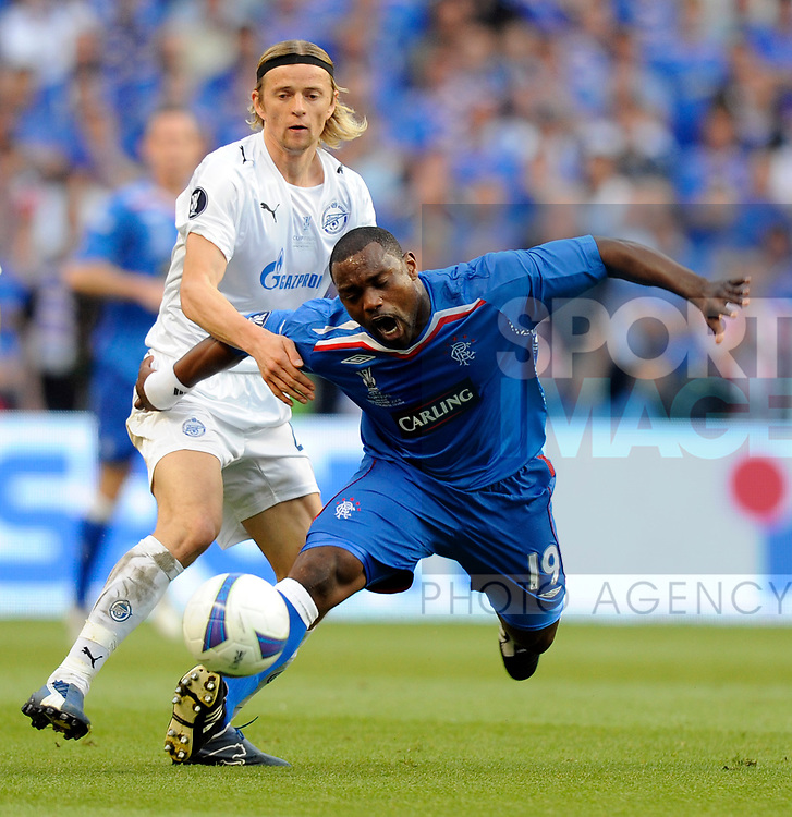 Jean-Claude Darcheville of Rangers challenged by Anatoliy Tymoshchuk of Zenit St Petersburg during the Europa League Final match at The Etihad Stadium, Manchester. Picture date 14th May 2008. Picture credit should read: Simon Bellis/Sportimage