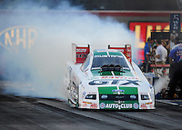 Oct. 31, 2008; Las Vegas, NV, USA: NHRA funny car driver Ashley Force does a burnout during qualifying for the Las Vegas Nationals at The Strip in Las Vegas. Mandatory Credit: Mark J. Rebilas-