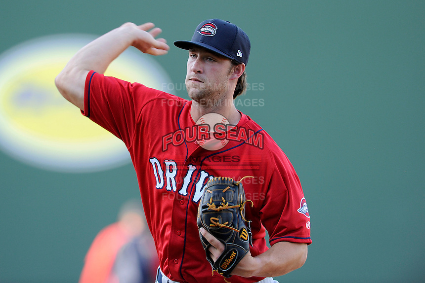 Pitcher Jacob Dahlstrand (26) of the Greenville Drive works on a pitcher fielding drill on the team's Media Day first workout on Tuesday, April 1, 2014, at Fluor Field at the West End in Greenville, South Carolina. (Tom Priddy/Four Seam Images)