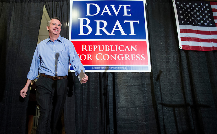UNITED STATES - OCTOBER 15: Ed Gillespie, Virginia candidate for U.S. Senate, arrives on stage for the campaign rally with House candidate Dave Brat and Sen. Rand Paul, R-Ky., in Ashland, Va., on Wednesday, Oct. 15, 2014. (Photo By Bill Clark/CQ Roll Call)
