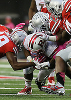 Rutgers Scarlet Knights quarterback Gary Nova (10) is sacked Ohio State Buckeyes safety Tyvis Powell (23) and Ohio State Buckeyes cornerback Gareon Conley (19) in the third quarter of their game at Ohio Stadium in Columbus, Ohio on October 18, 2014. (Columbus Dispatch photo by Brooke LaValley)