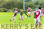Nollaig Ó hUiginn Lispole gets to the loose ball ahead of Brendan Foley Cromane collide during their Novice Championship semi final in Keel on Saturday