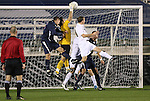13 November 2009: Wake Forest's Akira Fitzgerald (in yellow) catches the ball in traffic. The University of Virginia Cavaliers defeated the Wake Forest University Demon Deacons 4-3 on penalty kicks after the game ended in a 0-0 tie after overtime at WakeMed Stadium in Cary, North Carolina in an Atlantic Coast Conference Men's Soccer Tournament Semifinal game.