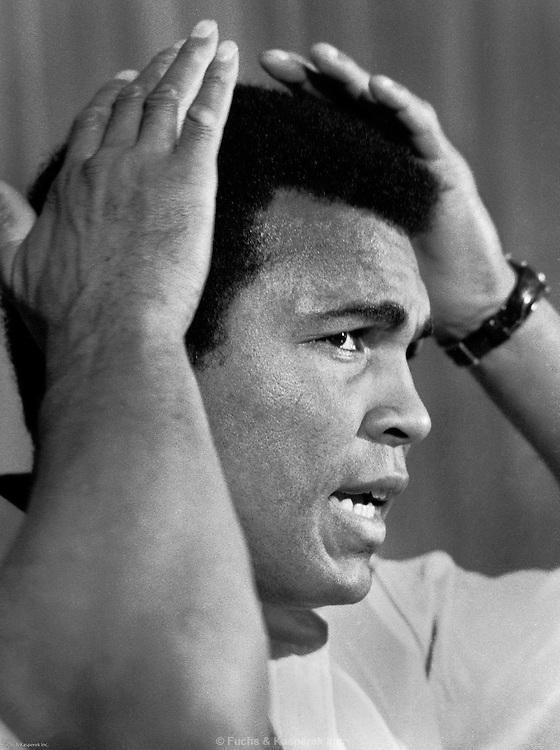 Muhammad Ali primps at a press conference in Gulfport, AL in 1978.