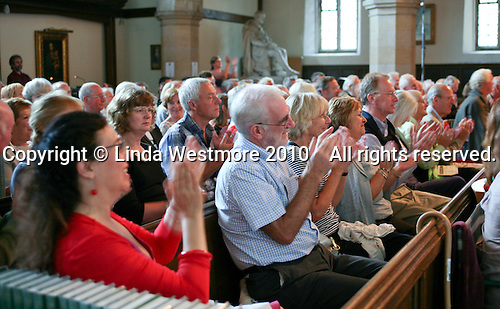 Audience applauds, St Mary's Church, Petworth Festival, West Sussex.