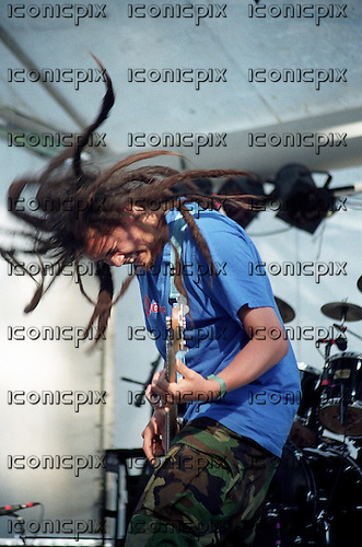 Deftones - bassist Chi Cheng - performs on the Warped Tour in Vancouver BC Canada - July 10 1996.  Photo credit: Ashley Maile/Iconicpix  **NO WEBSITES* *.© Ashley Maile.