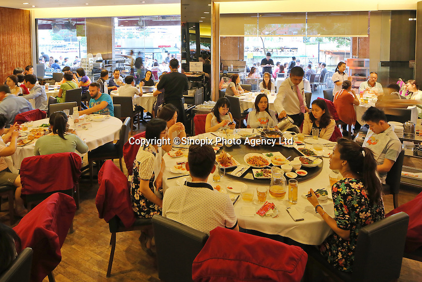 Diners at the Jumbo Seafood chain in Singapore, in Singapore, 14 March 2015.