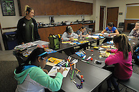 NWA Democrat-Gazette/FLIP PUTTHOFF <br /> SPRING BREAK BIRDS<br /> Caitlin Mitchell, college intern, helps students do art work Wednesday March 23, 2016 during Spring Break Day Camp  at Hobbs State Park-Conservation Area. Students take part in a variety of nature activities with guidance from Mitchell and Rebekah Penny, park interpreter. The park also hosted dozens of students from Camp War Eagle on Wednesday who did trail work on the Dutton Hollow Loop of the park's multiuse trail for hikers, horse-back riders and mountain bikers.