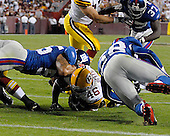 Landover, MD - September 23, 2007 -- New York Giants defense swarms Washington Redskin running back Ladell Betts (46) to stop him short of the goal line on fourth down assuring their first victory of the season against the Washington Redskins at FedEx Field in Landover, MD on Sunday, September 23, 2007.  The Giants won the game 24 - 17..Credit: Ron Sachs / CNP.(RESTRICTION: NO New York or New Jersey Newspapers or newspapers within a 75 mile radius of New York City)
