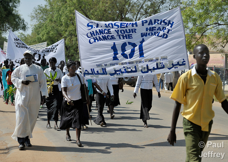 Catholics in Southern Sudan participate in a procession through the streets of Juba on November 20 to pray for a peaceful January 2011 referendum on secession from the north of the country. The independence vote has widespread support throughout Southern Sudan, including among Christians. The banner refers to a church-sponsored ecumenical campaign of 101 days of prayer for a peaceful referendum. NOTE: In July 2011 Southern Sudan became the independent country of South Sudan.