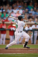 Dayton Dragons first baseman Avain Rachal (20) follows through on a swing during a game against the Cedar Rapids Kernels on May 10, 2017 at Fifth Third Field in Dayton, Ohio.  Cedar Rapids defeated Dayton 6-5 in ten innings.  (Mike Janes/Four Seam Images)