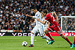 Carlos Henrique Casemiro (L) of Real Madrid is tackled by Thomas Muller of FC Bayern Munich during the UEFA Champions League Semi-final 2nd leg match between Real Madrid and Bayern Munich at the Estadio Santiago Bernabeu on May 01 2018 in Madrid, Spain. Photo by Diego Souto / Power Sport Images