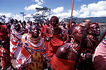 Maasai women, men  and girls dressed in their best jewellery  as part of the initiation into manhood of the moran ( young men) <br />
