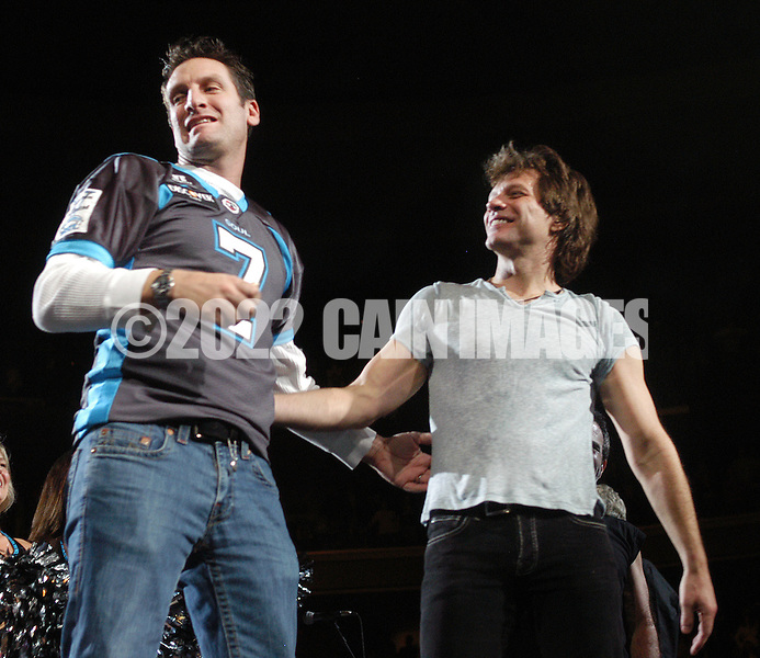PHILADELPHIA - MARCH 2: Jon Bon Jovi stands on stage with Philadelphia Soul quarterback Tony Graziani (7) at the Wachovia Center as the audience sings Happy Birthday to him March 2, 2008 in Philadelphia, Pennsylvania. Members of his football team, the Philadelphia Soul and the Soul Dancers came on stage to sing him Happy Birthday and present him with a cake in celebration of his 46th birthday. (Photo by William Thomas Cain/Getty Images)