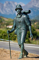 Hiker bronze statue on Pilgrim's Way at Potes in Picos de Europa, Asturias, Northern Spain