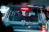 "A Secret Service agent in the ""war wagon"" trails President-Elect Barack Obama's motorcade as it winds its way thogh Chicago traffic."