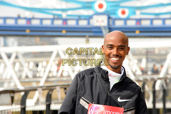 Mo Farah.London Marathon Winners photocall, Tower Hotel, London, England..April 22nd, 2013.half length black top smiling goatee facial hair headshot portrait.CAP/CJ.©Chris Joseph/Capital Pictures.