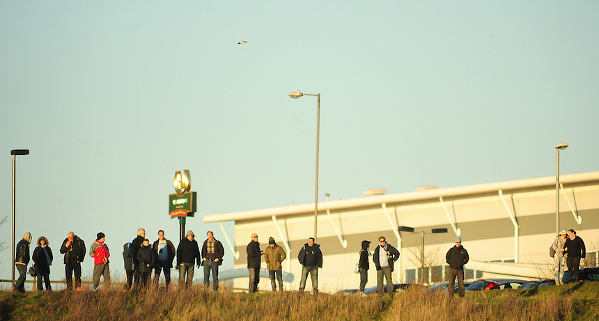 People watch the game between Coventry City and Oldham Athletic from the grass bank overlooking the Sixfields Stadium<br /> <br /> Photo by Chris Vaughan/CameraSport<br /> <br /> Football - The Football League Sky Bet League One - Coventry City v Oldham Athletic - Sunday 29th December 2013 - Sixfields Stadium - Northampton<br /> <br /> &copy; CameraSport - 43 Linden Ave. Countesthorpe. Leicester. England. LE8 5PG - Tel: +44 (0) 116 277 4147 - admin@camerasport.com - www.camerasport.com