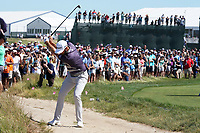 Dustin Johnson (USA) hits his second shot off the cart path resulting in a double bogey on the second hole during the third round of the 118th U.S. Open Championship at Shinnecock Hills Golf Club in Southampton, NY, USA. 16th June 2018.<br /> Picture: Golffile | Brian Spurlock<br /> <br /> <br /> All photo usage must carry mandatory copyright credit (&copy; Golffile | Brian Spurlock)