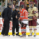 Scott Hansen, Jeff Bunyon, Mike McLaughlin (Northeastern - 18), Tommy Cross (BC - 4) - The Boston College Eagles defeated the Northeastern University Huskies 7-1 in the opening round of the 2012 Beanpot on Monday, February 6, 2012, at TD Garden in Boston, Massachusetts.