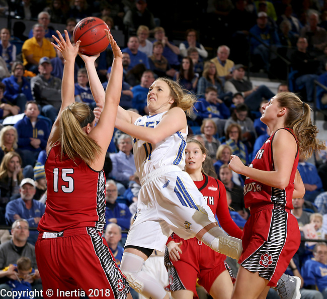 BROOKINGS, SD - JANUARY 25: Madison Guebert #11 from South Dakota State University takes the ball to the basket against Taylor Frederick #15 from the University of South Dakota during their game Thursday night at Frost Arena in Brookings. (Photo by Dave Eggen/Inertia)