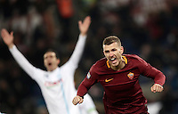 Calcio, Serie A: Roma vs ChievoVerona. Roma, stadio Olimpico, 22 settembre 2016.<br /> Roma&rsquo;s Edin Dzeko celebrates after scoring during the Italian Serie A football match between Roma and Chievo Verona, at Rome's Olympic stadium, 22 December 2016.<br /> UPDATE IMAGES PRESS/Isabella Bonotto