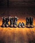 Muddy loafers amongst muddy combat boots