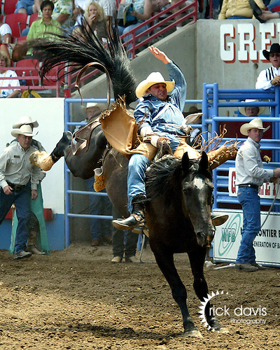 Jess Davis scores a 79 point bareback ride on Beutler and Son Rodeo Company bronc Wayward Winds during the short go round of the 2006 Greeley Independence Stampede Rodeo on July 4, 2006.<br />