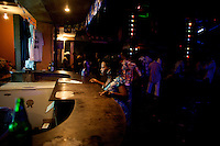 A woman asks for a drink at the bar of the Shrine, a famous nightclub home of Fela Kuti's son Femi,  in Nigeria's capital Lagos on Monday March 30 2009..The club was home to the king of Afrobeat, Fela Anikulapo Kuti, who died in 1997 from Aids-related reasons..For more than two decades Fela performed at the shrine with the same incredible energy with which he enjoyed drugs and women..The shrine - then a dingy club on the outskirts of Lagos that became a legend - closed soon after Fela's death.