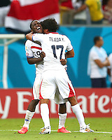 Joel Campbell and Yeltsin Tejeda of Costa Rica celebrate winning the penalty shoot out and progressing to the quarter finals