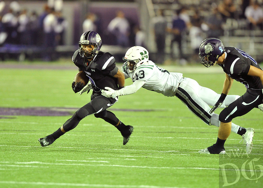 NWA Democrat-Gazette/MICHAEL WOODS &bull; @NWAMICHAELW<br /> Fayetteville High School receiver Terrance Rock (9) tries to shake Muskogee defender Tavian Davis (13) during the first half of the Bulldogs game Friday September 18, 2015 in Fayetteville.