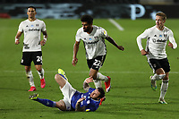 10th July 2020; Craven Cottage, London, England; English Championship Football, Fulham versus Cardiff City; Cyrus Christie of Fulham fouls Lee Tomlin of Cardiff City