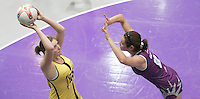 04 MAY 2007 - LOUGHBOROUGH, UK - Natalie Woolley attempts to shoot over Hannah Reid - Loughborough Lightning (Purple) v Northern Thunder (Yellow). (PHOTO (C) NIGEL FARROW)