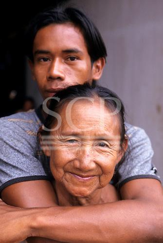 Altamira, Amazon, Brazil. Brazil nut oil factory; Dona Xipaya and her son Tatu.